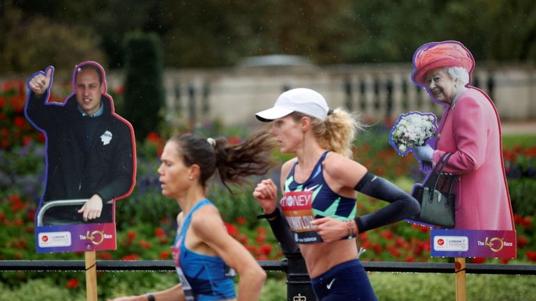 Athletics - London Marathon - London, Britain - October 4, 2020 Runners run past a cardboard cut-out of Britain's Queen Elizabeth and Prince William during the elite women's race of the London Marathon Pool via REUTERS/John Sibley TPX IMAGES OF THE DAY