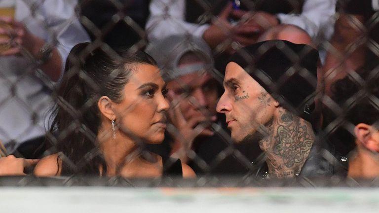 Jul 10, 2021; Las Vegas, Nevada, USA; American socialite Kourtney Kardashian and American musician Travis Barker attend UFC 264 at T-Mobile Arena. Mandatory Credit: Gary A. Vasquez-USA TODAY Sports