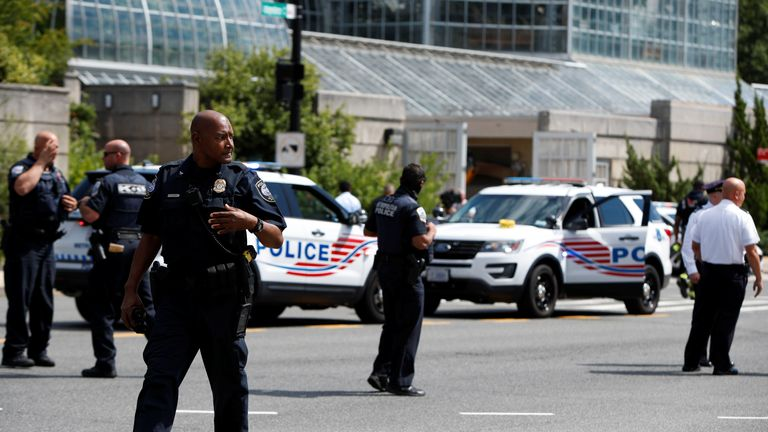 Police officers man a police barricade while responding to a bomb threat near the U.S. Capitol in Washington, U.S., August 19, 2021. REUTERS/Gabrielle Crockett