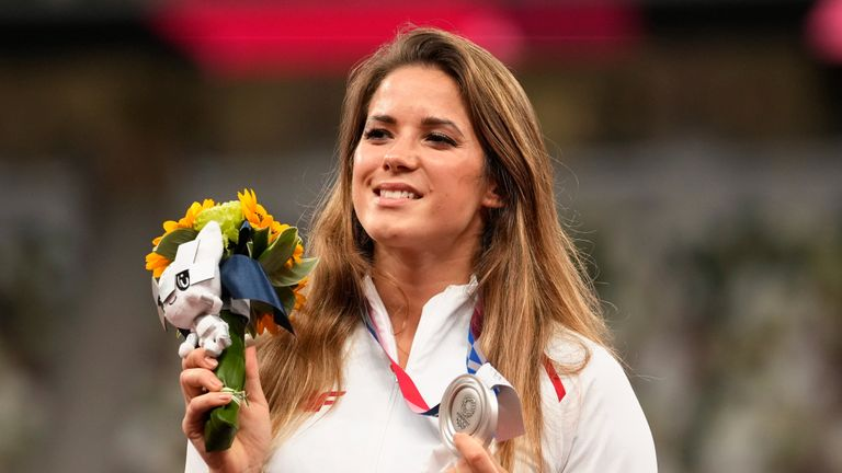 Silver medalist Maria Andrejczyk, of Poland, poses on the podium during the medal ceremony for the women's javelin throw at the 2020 Summer Olympics, Saturday, Aug. 7, 2021, in Tokyo. (AP Photo/Martin Meissner)