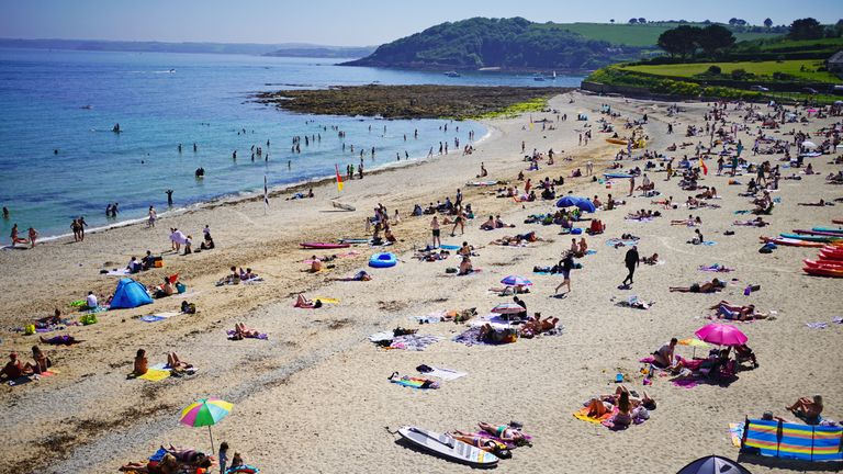 People enjoy the sunshine on Gyllyngvase Beach near Falmouth in Cornwall. Picture date: Sunday June 13, 2021.
