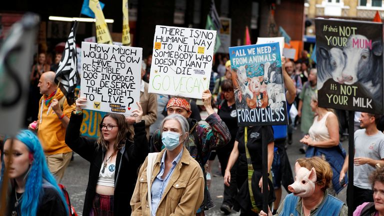 Extinction Rebellion climate activists take part in a protest in London, Britain August 28, 2021. REUTERS/Peter Nicholls