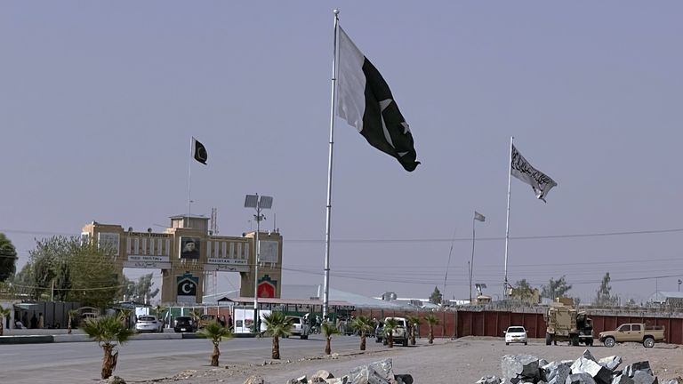 Pakistan and Taliban flags are seen on their respective sides near Friendship gate at a border crossing point in Chaman, Pakistan, Friday, Aug. 27, 2021. Hundreds of Pakistanis and Afghans cross the border daily through Chaman to visit relatives, receive medical treatment and for business-related activities. Pakistani has not placed any curbs on their movement despite recent evacuations from Kabul. (AP Photo)
