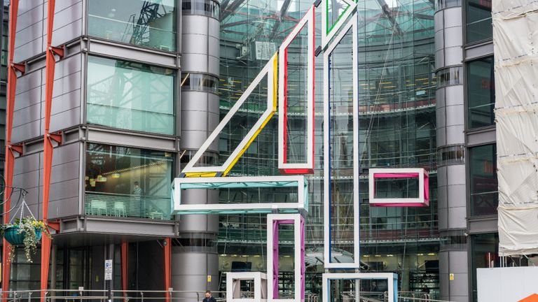 London, UK - Pedestrians on the street in front of the headquarters building of the UK television broadcaster Channel 4, located in Westminster.