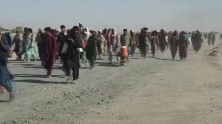Crowds gather at the border between Afghanistan and Pakistan, as people flee from the Taliban.