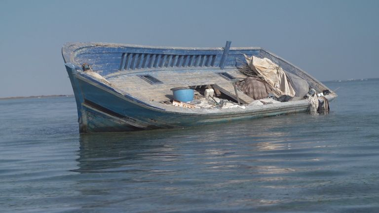 Small boats which once carried migrants are now empty other than pieces of rubbish visible inside the vessels