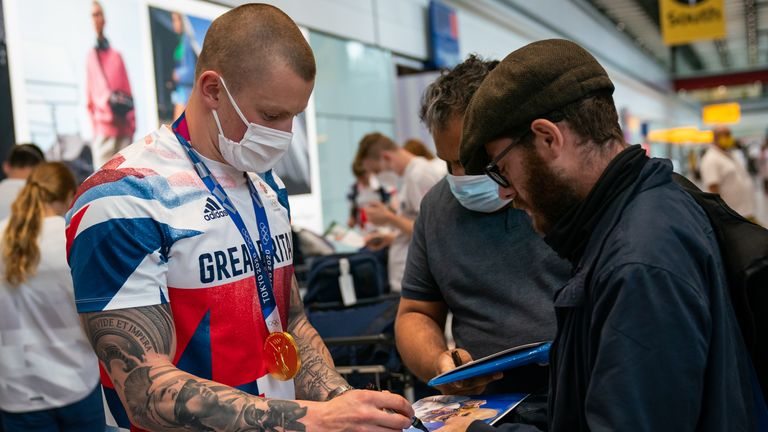 British swimmer Adam Peaty arrives back at London Heathrow Airport from the Tokyo 2020 Olympic Games. Picture date: Monday August 2, 2021.