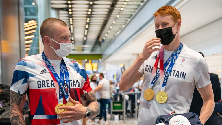 British swimmer Adam Peaty (left) and Tom Dean arrive back at London Heathrow Airport from the Tokyo 2020 Olympic Games. Picture date: Monday August 2, 2021.