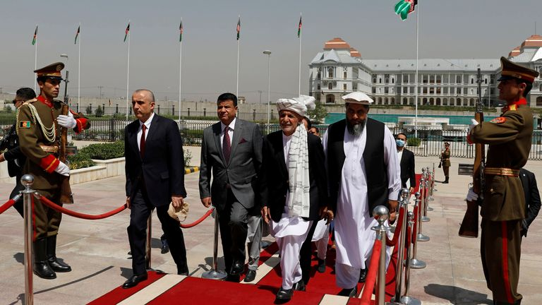 Afghan President Ashraf Ghani inspects the honour guard as he arrives at the parliament in Kabul, Afghanistan August 2, 2021. REUTERS/Stringer