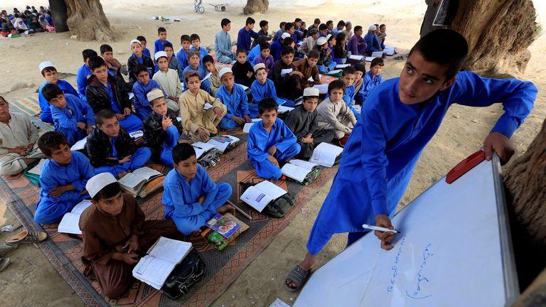 Afghan children study at an open area in Ghani Khel district of Jalalabad, Afghanistan November 6, 2017