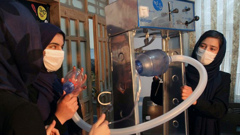 FILE PHOTO: Members of an Afghan all-female robotics team work on an open-source and low-cost ventilator, during the coronavirus disease (COVID-19) outbreak in Herat Province, Afghanistan April 15, 2020. Picture taken April 15, 2020.REUTERS/Jalil Ahmad/File Photo
