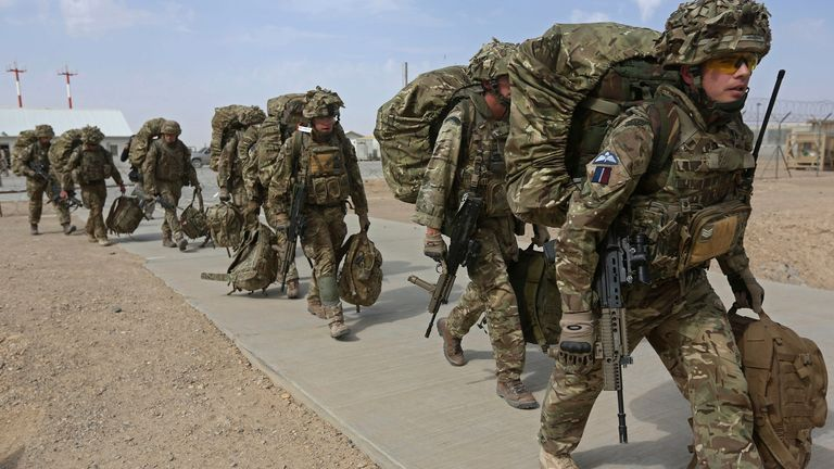 British troops prepare to depart upon the end of operations for U.S. Marines and British combat troops in Helmand October 27, 2014