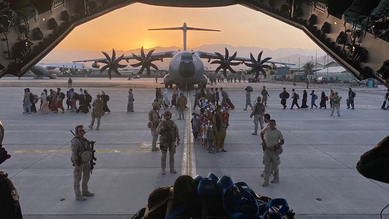 Afghan collaborators, their families, Spanish soldiers and members of the embassy board a Spanish military plane as part of their evacuation, at the Hamid Karzai International Airport in Kabul, Afghanistan, August 27, 2021. Ministry of Defense of Spain/Handout via REUTERS THIS IMAGE HAS BEEN SUPPLIED BY A THIRD PARTY. MANDATORY CREDIT. NO RESALES. NO ARCHIVES.