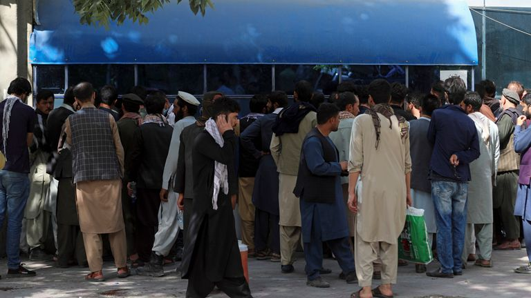 Afghans wait in long lines for hours in front of Kabul Bank to get their money. Pic: AP
