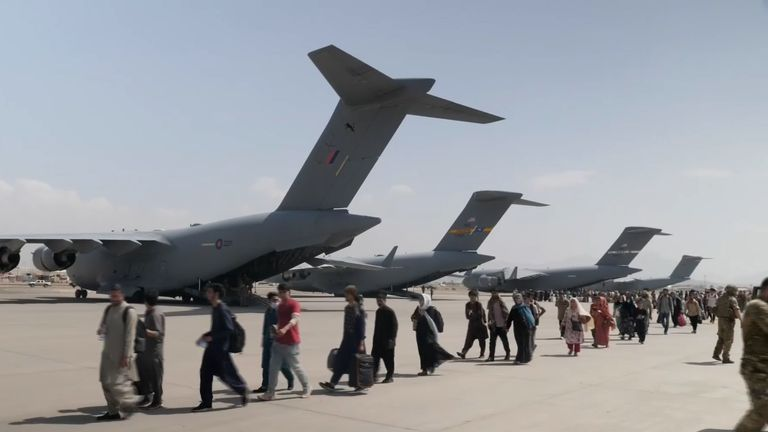 British evacuees board planes as they flee the Taliban's takeover in Afghanistan.