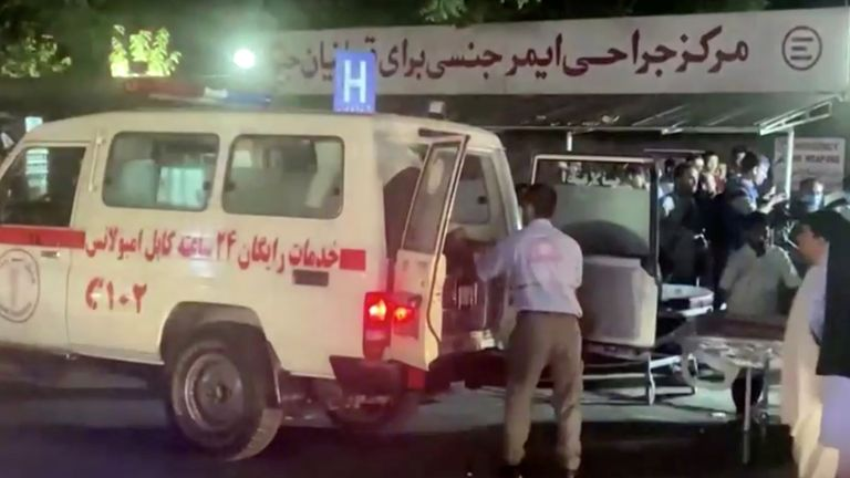 A screen grab shows an emergency vehicle as people arrive at a hospital after an attack at Kabul airport, in Kabul, Afghanistan August 26, 2021. REUTERS TV/via REUTERS