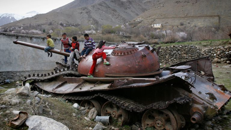 In this 2011 photo, Afghan children play on a destroyed Soviet - made armored tank in Panjshir north of Kabul, Afghanistan. Pic: AP