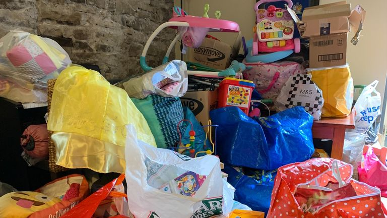 Around 30 volunteers were sorting clothing, toiletries, toys, bedding, nappies and other items into bags