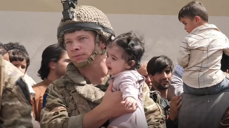 British soldier carrying baby