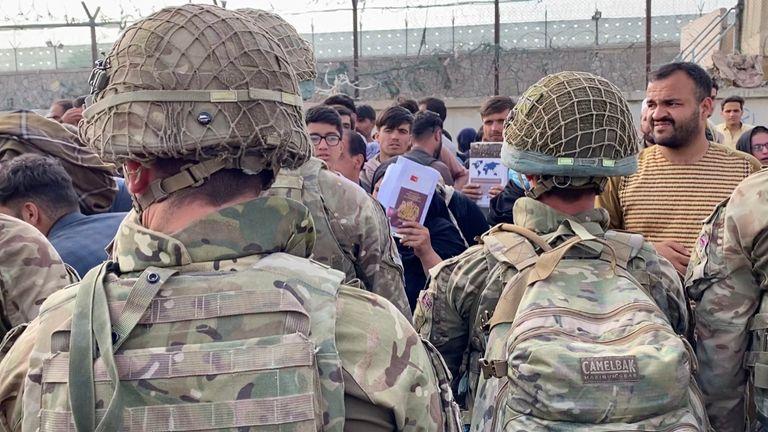 Evacuee holds up British passport