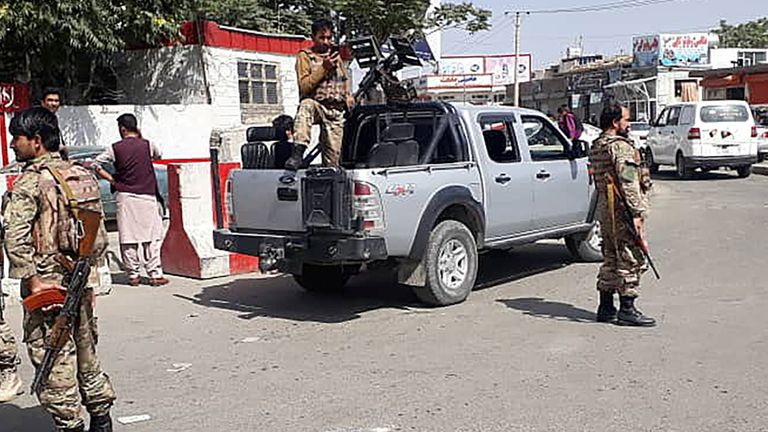 Afghan security forces guard the entrance to Kabul airport