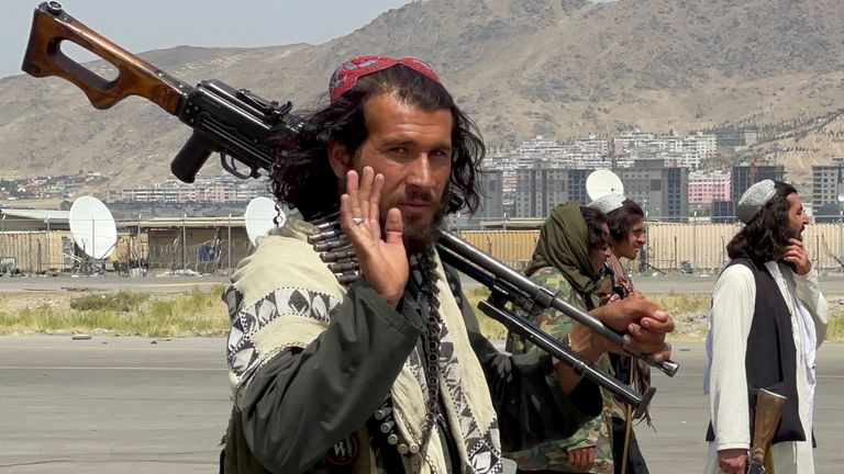 Taliban forces patrol at a runway a day after US troops withdrawal from Hamid Karzai International Airport in Kabul