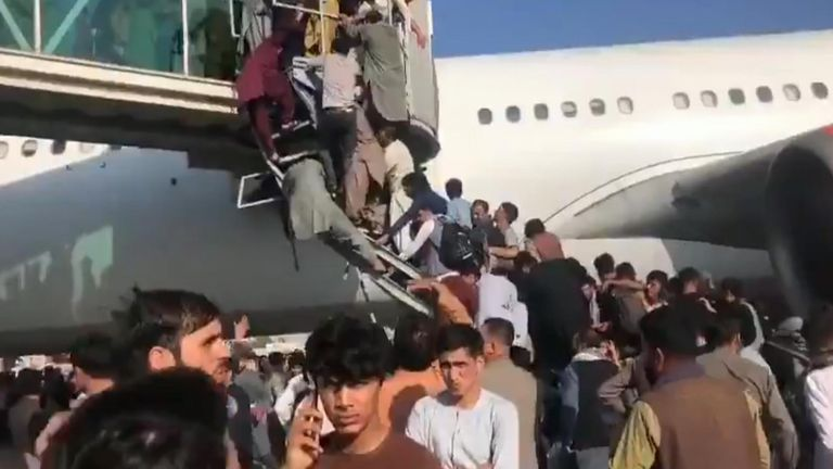 People have been trying to climb on to an airbridge at Kabul airport