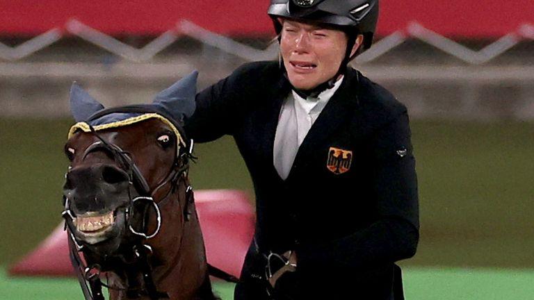 Annika Schleu struggles to control the horse Saint Boy during the pentathlon in the Olympics.
