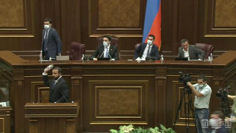Officials grappled and hurled objects in footage shown on Armenian television