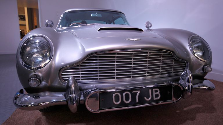 One of the four Aston Martin DB5s used in the James Bond film Goldfinger (two for filming, two for promotion) is seen at the opening of the Bond in Motion 50 Vehicles in 50 Years exhibition in 2012. Photo: AP