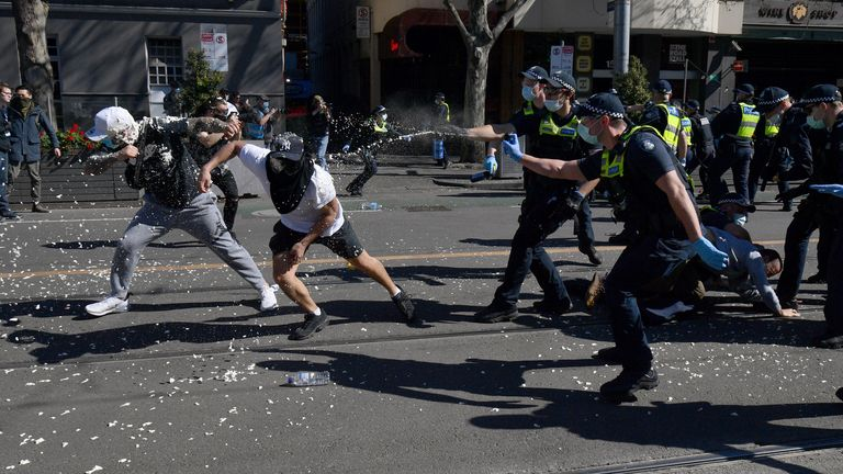 Police and protestors classed during a demonstration in Melbourne. Pic AP