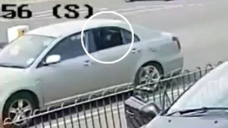 CCTV shows a gun pointing from the back window of the car as it drove by Quick Shine