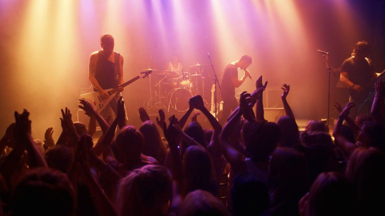 A band playing a live gig on stage