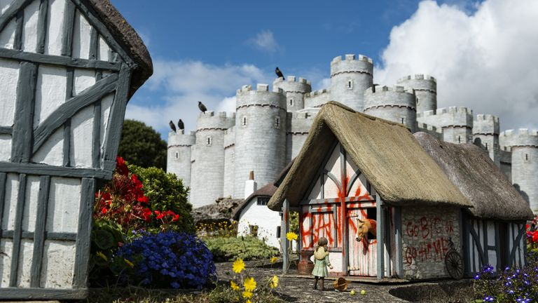 One of the new works by Banksy, on one of the model houses in the Merrivale Model Village