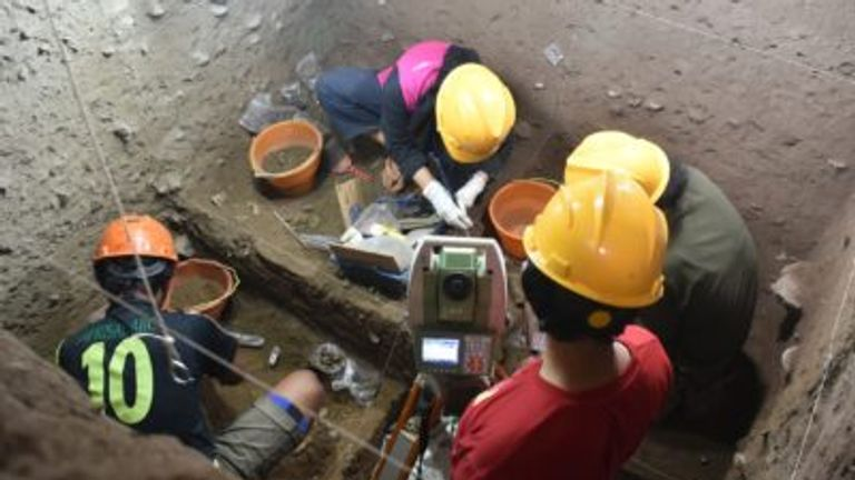 Archaeologists excavate at Leang Panninge cave on Sulawesi. Pic: Leang Panninge Research Project