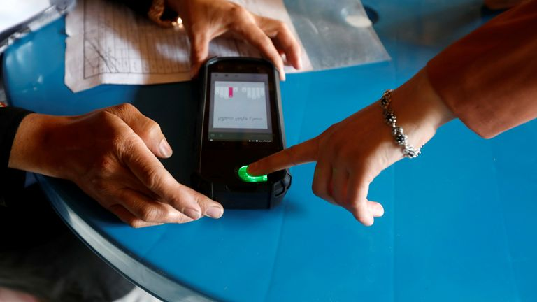 Fingerprint scanners, iris scanners and other biometric equipment was used to verify voters during the Afghan elections in 2019 to prevent voter fraud. Pic: Omar Sobhani/Reuters