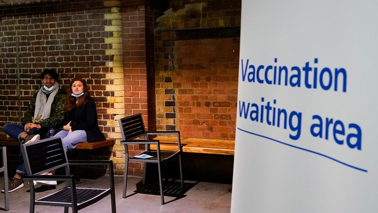 Patients wait after receiving the Covid vaccine at Heaven club in London, Sunday, Aug. 8, 2021. London's Heaven club has become the UK's first nightclub to be turned into a pop-up Covid vaccination centre. (AP Photo/Alberto Pezzali)