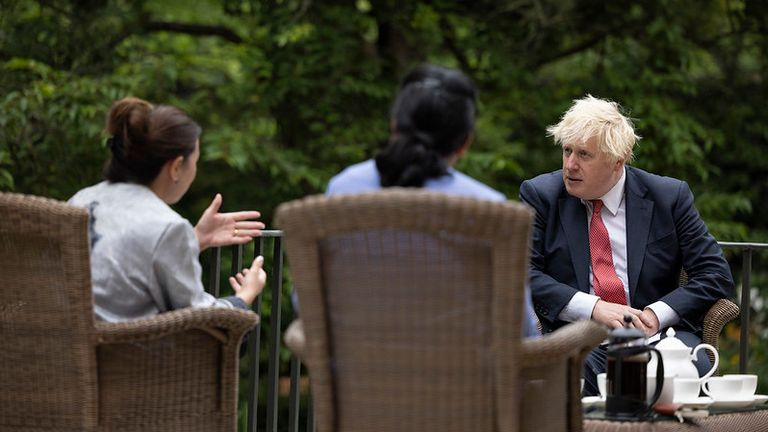 20/08/2021. London, United Kingdom. Prime Minister Boris Johnson speaks with Afghans who have relocated to Britain through the Afghan Relocations and Assistance Policy (ARAP) in the gardens of 10 Downing Street. Pic: Simon Dawson/Downing St