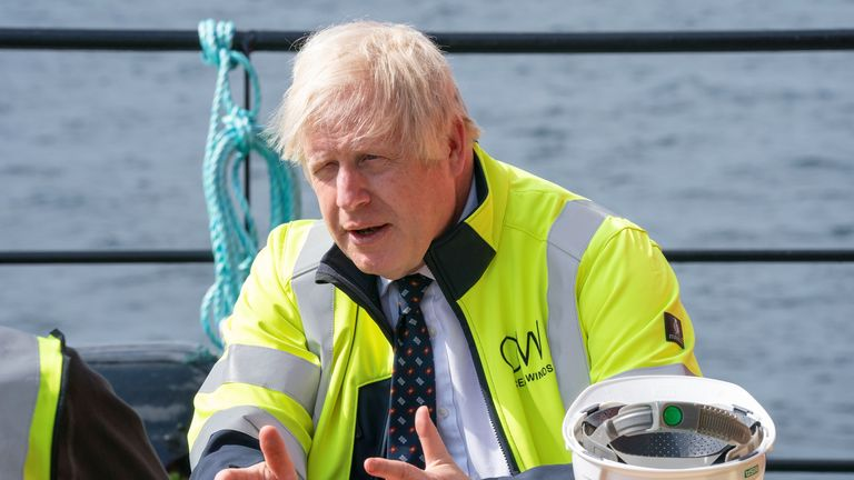 British Prime Minister Boris Johnson gestures as he meets members of the crew onboard the Esvagt Alba during a visit to the Moray Offshore Windfarm East off the Aberdeenshire coast, during his visit to Scotland, Britain, August 5, 2021. Jane Barlow/Pool via REUTERS
