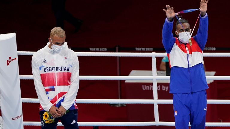 Gold Medalist Arlen Lopez, of Cuba (right) holds up his medal as sliver medalist Whittaker, looks on. Pic: AP