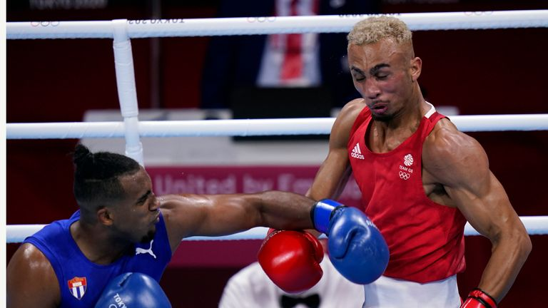 Arlen Lopez, of Cuba (left) punches Benjamin Whittaker (right) during their light heavy weight 75-81kg finals boxing match. Pic: AP