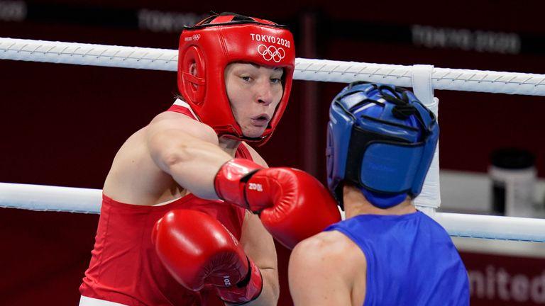 Lauren Price (left) exchanges punches with Nouchka Fontlijn (right) of the Netherlands. Pic: AP