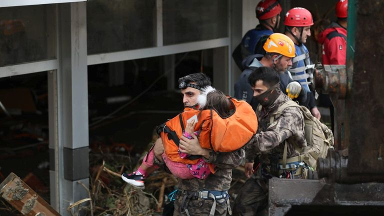 Search and rescue teams have been helping evacuate residents in Bozkurt, including this girl