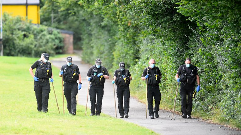 Police searched the area following the discover of the boy's body. Pic: Wales News Service