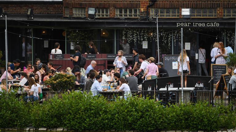 People enjoy the warm weather at the Pear Tree Cafe