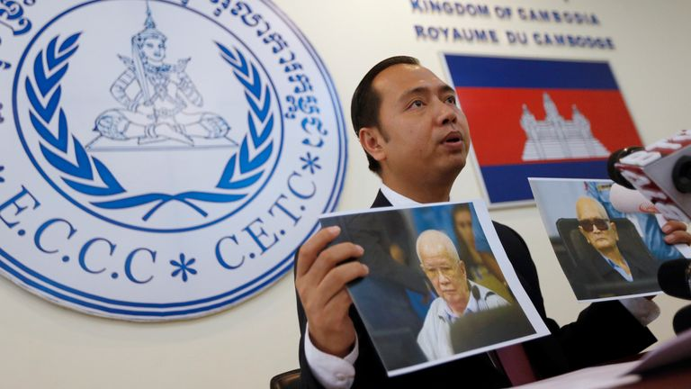 Neth Pheaktra, Press Officer at the Extraordinary Chambers in the Courts of Cambodia (ECCC), shows portraits of the former Khmer Rouge head of state Khieu Samphan and former Khmer Rouge leader ''Brother Number Two'' Nuon Chea during a news conference at the ECCC in 2018