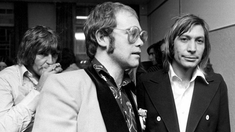 Elton John and Charlie Watts in 1975. Pic: Dezo Hoffman/Shutterstock