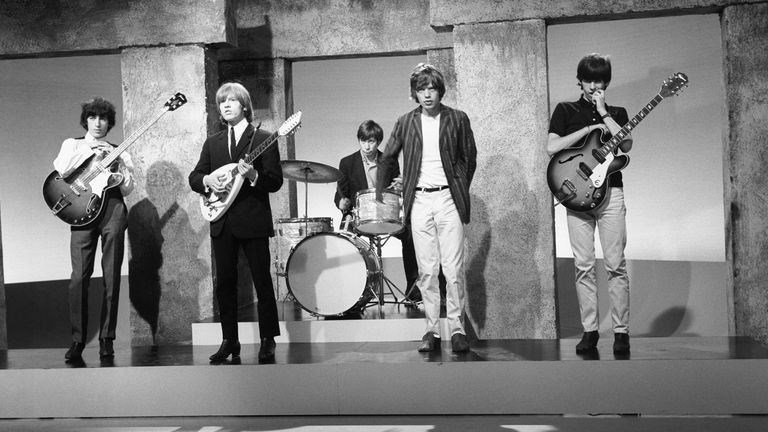 Charlie Watts, centre, with The Rolling Stones in 1964. (Left to right: Bill Wyman, Brian Jones, Charlie Watts, Mick Jagger, and Keith Richards)