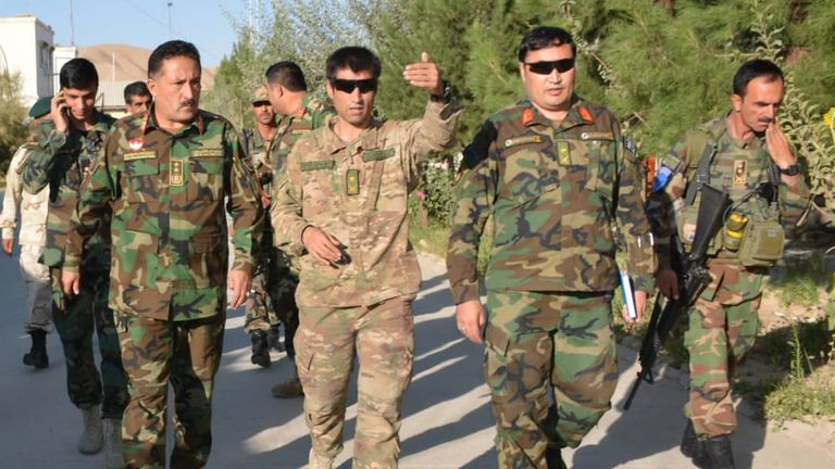 Colonel Rezai (second from right) believes the Taliban's rule may not last long