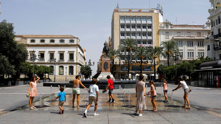 People in Cordoba cooled off in a fountain as the city baked in sweltering heat